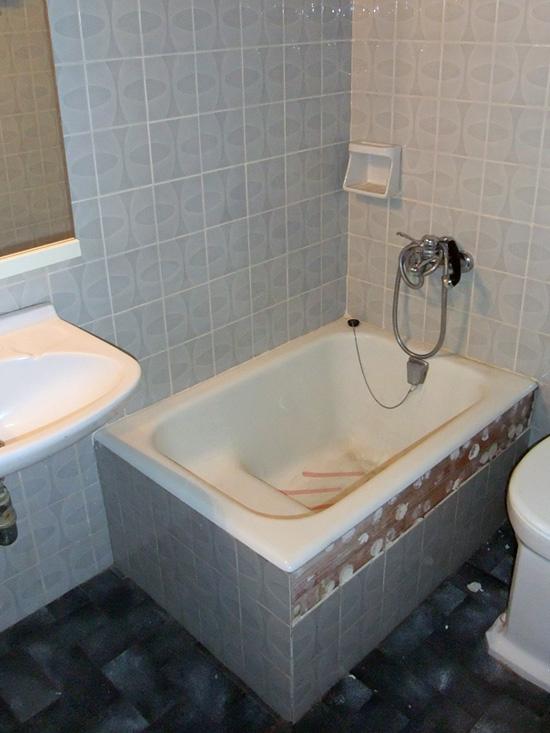 Sanear media bañera para instalar plato de ducha Roca